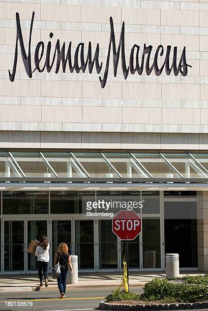 Shoppers head toward the entrance of a Neiman Marcus Inc department store at the Mall at Short Hills in Short Hills New Jersey US on Monday Sept 9...