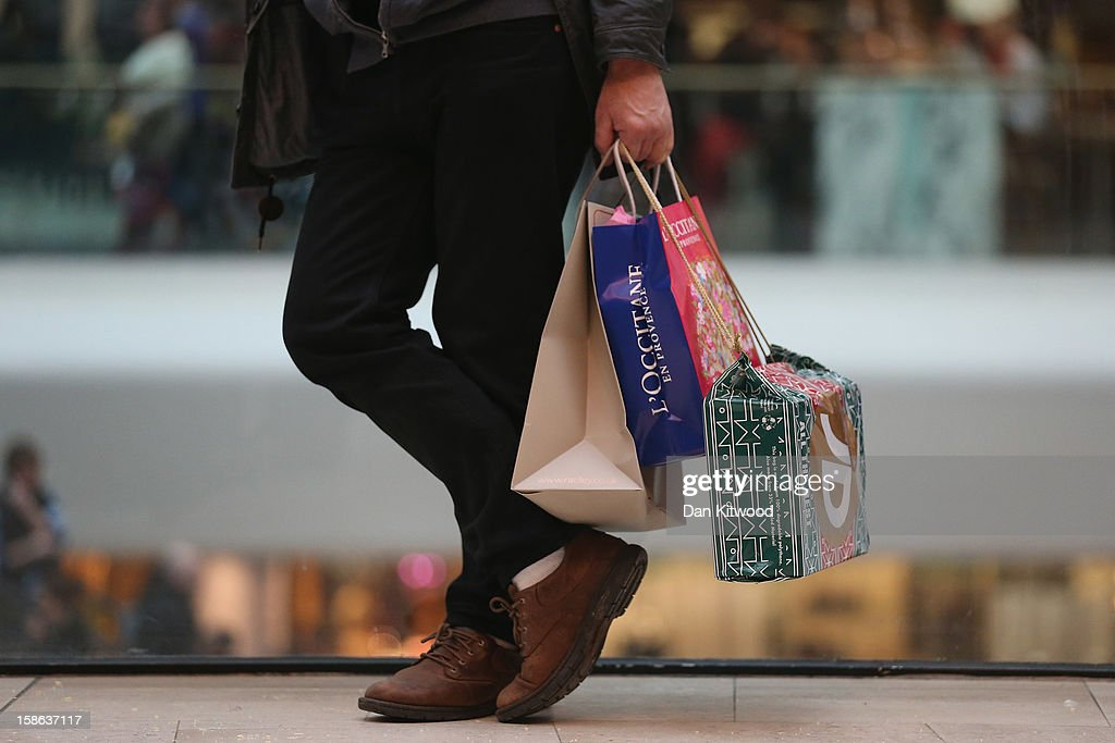 Shoppers hold bags in Westfield Shopping centre in West London on December 22, 2012 in London, England. Today is the final Saturday before Christmas.