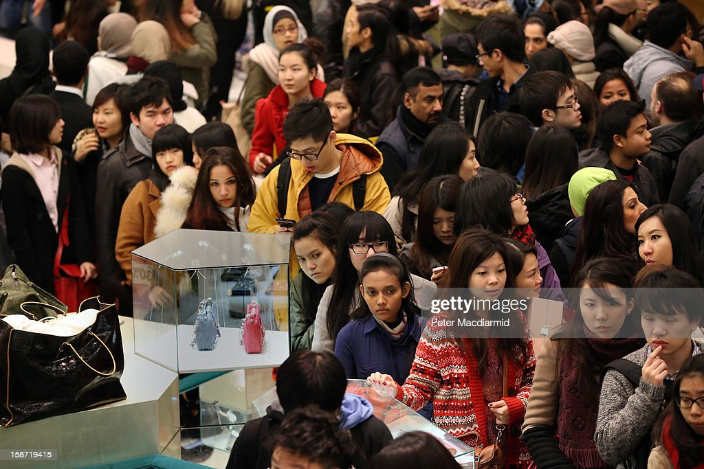 Shoppers hunt for bargains at Selfridges department store as their sale begins on December 26, 2012 in London, England. Thousands of shoppers are in London looking for a bargain in the traditional Boxing Day sales.