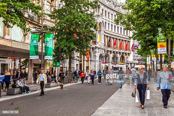 Shoppers hurrying along Meir which is the largest pedestrianised shopping street in Antwerp