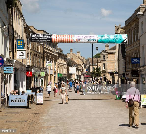 Shoppers in High Street Stamford Lincolnshire England UK