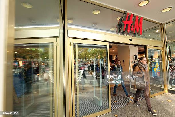 Shoppers leave a Hennes Mauritz store on October 25 2012 in Berlin Germany Retail business is the thirdbiggest economic sector in Germany and...