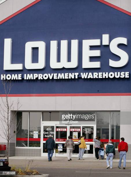 Shoppers leave a Lowe's store November 17 2003 in Merrillville Indiana Lowe's Cos Inc the world's second largest homeimprovement retailer after Home...