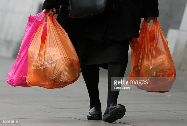 Shoppers leave a Sainsbury's store with their purchases in plastic bags on February 29 2008 in London England The Prime Minister Gordon Brown has...
