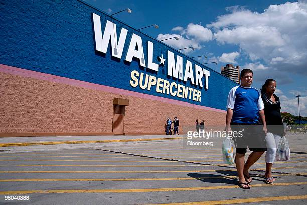 Shoppers leave a WalMart supercenter store in Sao Paulo Brazil on Monday March 8 2010 WalMart Stores Inc says it will spend $12 billion this year on...