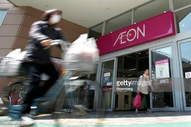 Shoppers leave an Aeon Co shopping center in Tokyo Japan on Thursday April 12 2012 Aeon Co Japan's largest supermarket operator reported consolidated...