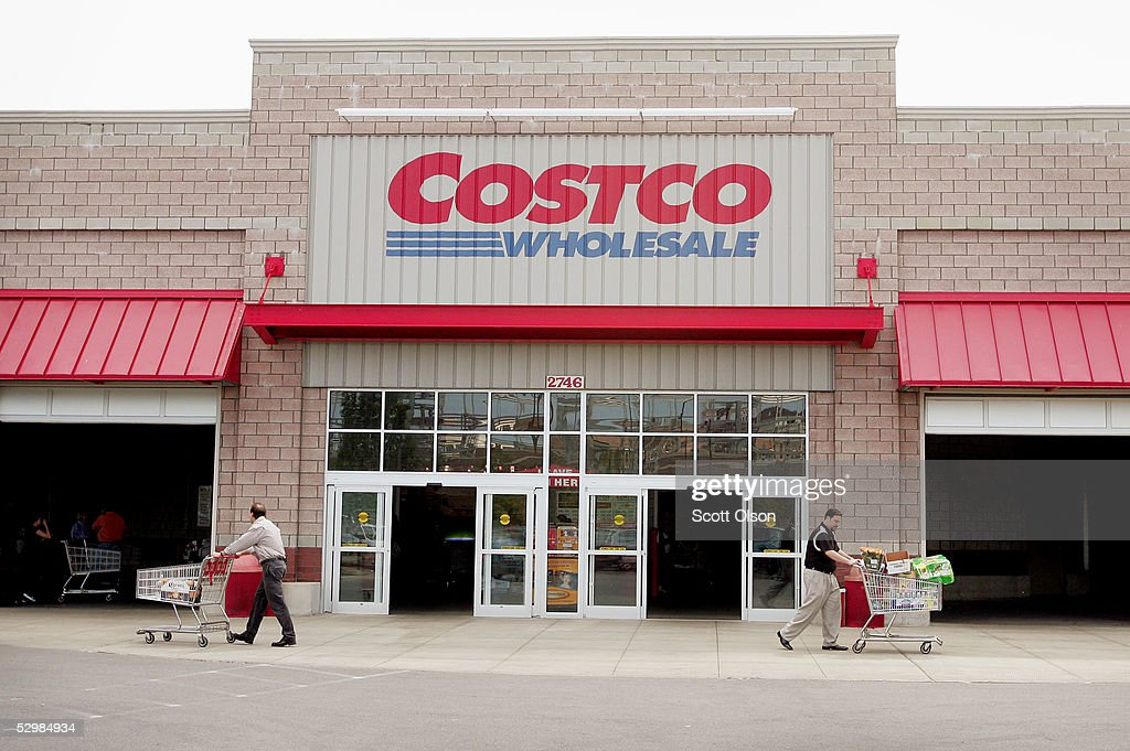 Shoppers leave the Costco Store May 26 2005 in Chicago Illinois Costco reported today an increase of six percent in third quarter profits over the...