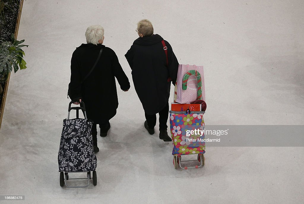 Shoppers leave The Ideal Home Christmas Show with their purchases on November 14, 2012 in London, England. Over 400 exhibitors are showcasing a range of gift ideas for Christmas at the Earls Court exhibition centre.