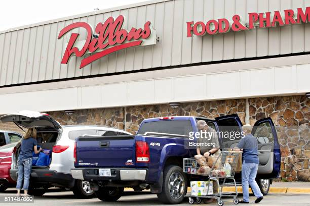 Shoppers load grocery bags into their vehicles outside of a Dillons Food Stores supermarket owned by Kroger Co in Hays Kansas US on Thursday June 29...