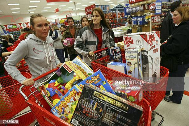 Shoppers load up their shopping baskets at Target November 24 2006 in Hobart Indiana Many shoppers ventured out for early morning deals as the...