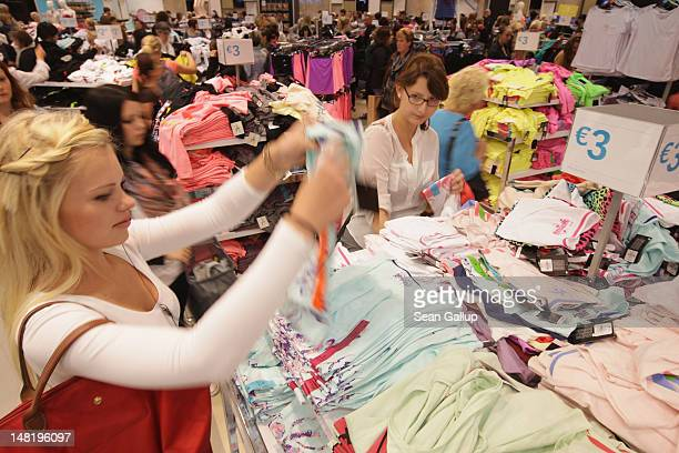 Shoppers look among women's fashion at a Primark clothing store a day after the store's opening on July 12 2012 in Berlin Germany Primark is...