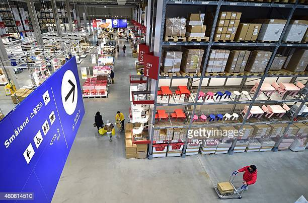 Shoppers look around in a store of Ikea in Gwangmyeong south of Seoul on December 18 2014 Global furniture giant Ikea opened its first store in South...