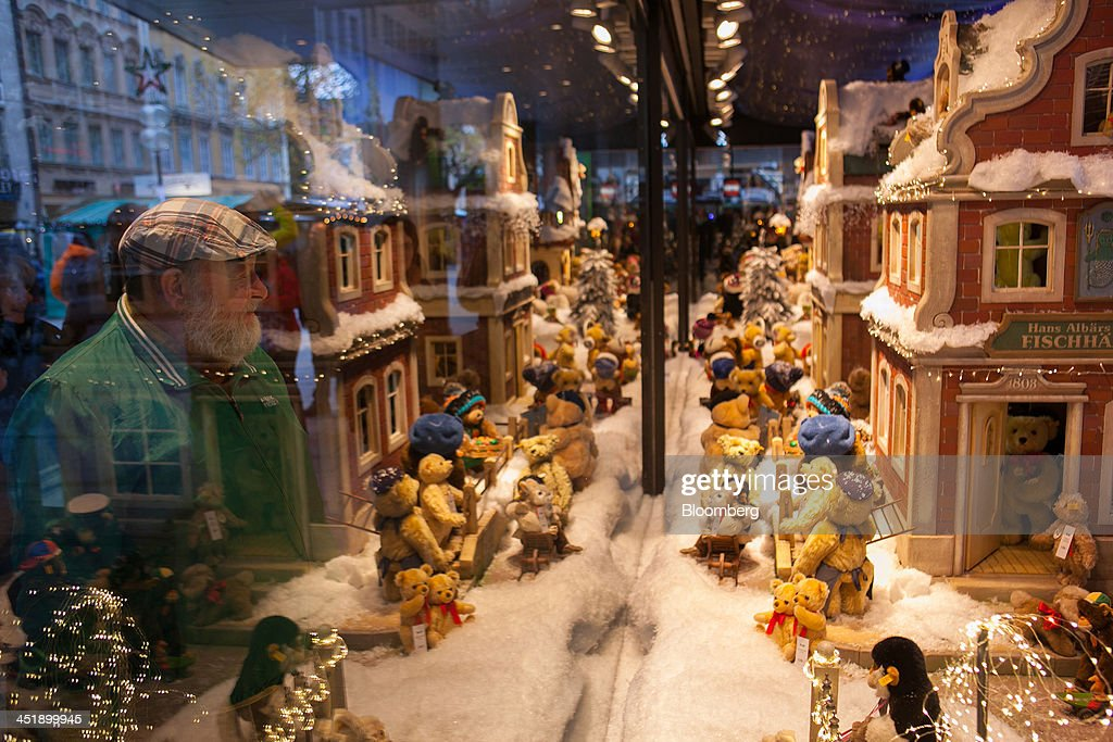 Shoppers look at a festive Christmas window display in a Galeria Kaufhof GmbH department store in Munich, Germany, on Sunday, Nov. 24, 2013. In Germany, Europe's biggest economy, annual consumer prices increased 1.2 percent in October. Photographer: Krisztian Bocsi/Bloomberg via Getty Images