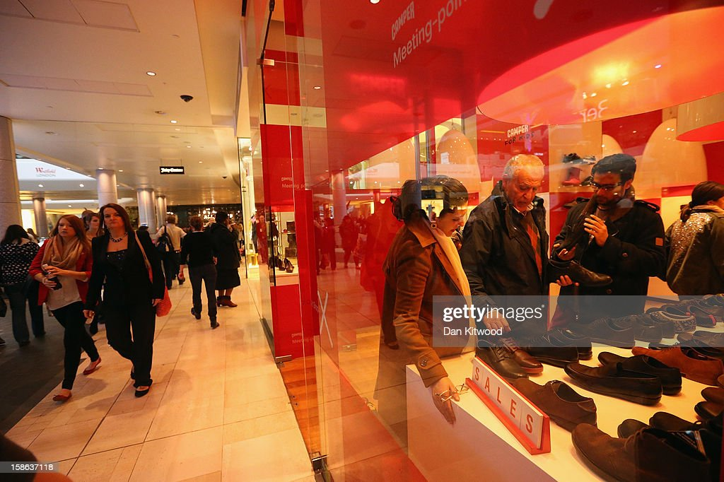 Shoppers look at goods in a shop in Westfield Shopping centre in West London on December 22, 2012 in London, England. Today is the final Saturday before Christmas.