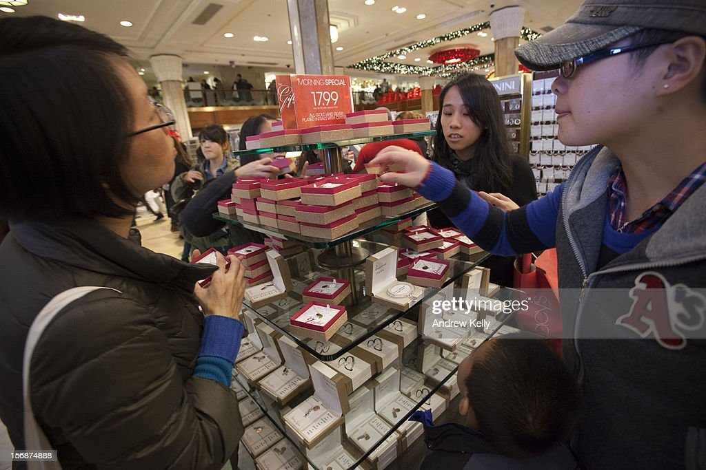 Shoppers look at jewelry in Macy's during the Black Friday sales on November 23, 2012 in New York City. People filled stores in search of the many potential bargains on offer during the traditional yearly sale, which got its name as it's said to put retailers 'in the black,' or making a profit.