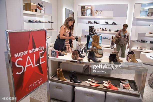 Shoppers look at shoes at a Macy's Inc department store in New York US on Monday August 10 2015 Macy's Inc the largest US departmentstore company is...