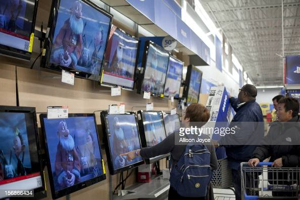 Shoppers look at televisions at Walmart during the Black Friday sales on November 23 2012 in Quincy Massachusetts Black Friday the start of the...