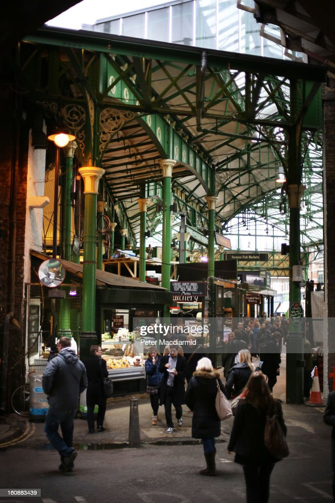 Shoppers look for bargains at Borough Market on February 7 2013 in London England Borough Market London's oldest since 1756 has recently completed...