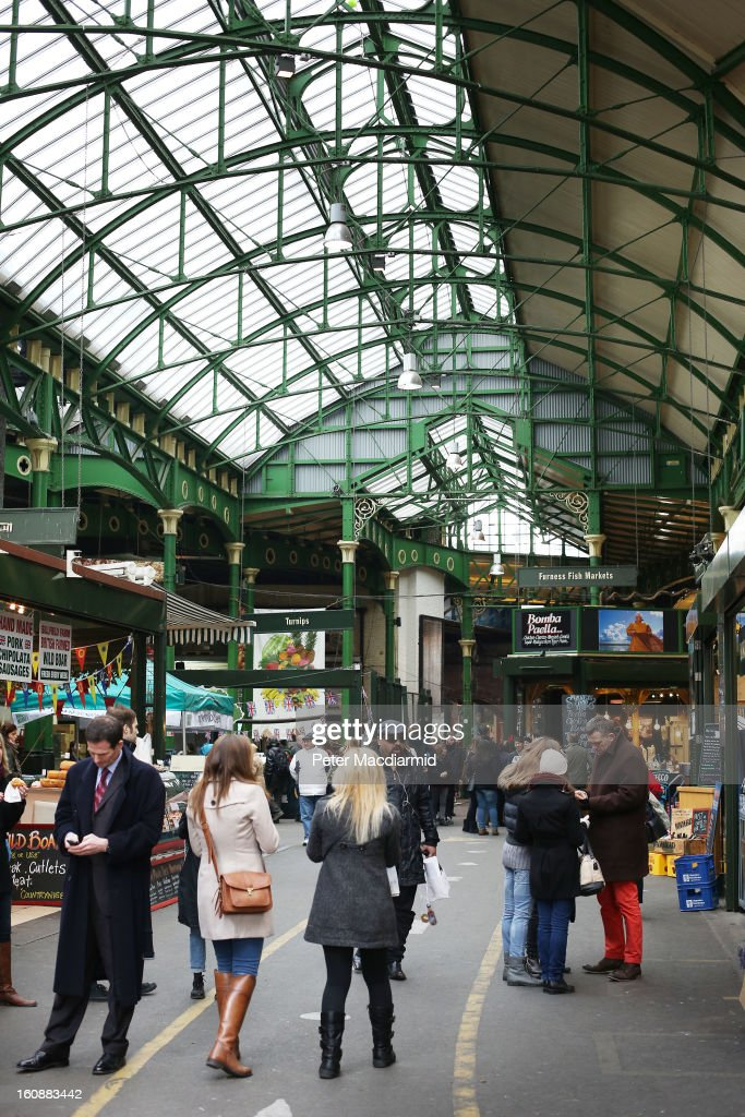 Shoppers look for bargains at Borough Market on February 7, 2013 in London, England. Borough Market, London's oldest since 1756, has recently completed renovation and today had it's first day of full trading.