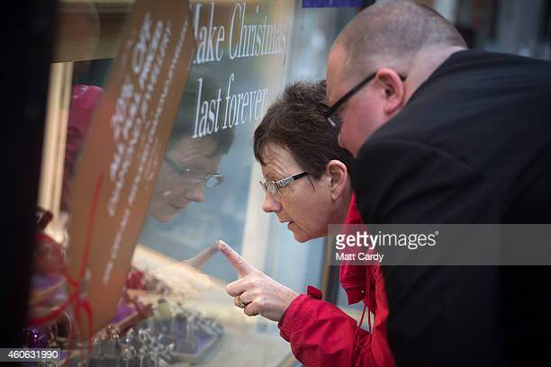 Shoppers look for Christmas gifts in a high street jewellery store on December 18 2014 in Bath England With less than a week until Christmas...