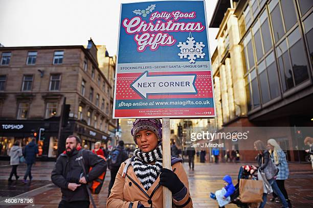 Shoppers look for Christmas gifts on the Buchanan street on December 19 2014 in GlasgowScotland With less than a week until Christmas traditional...