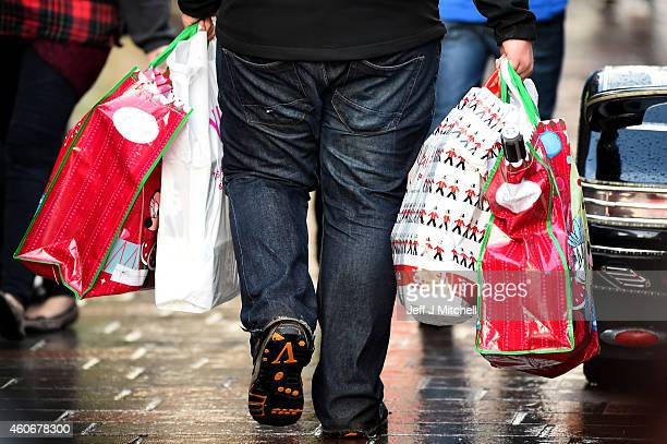 Shoppers look for Christmas gifts on the high street on December 19 2014 in GlasgowScotland With less than a week until Christmas traditional high...