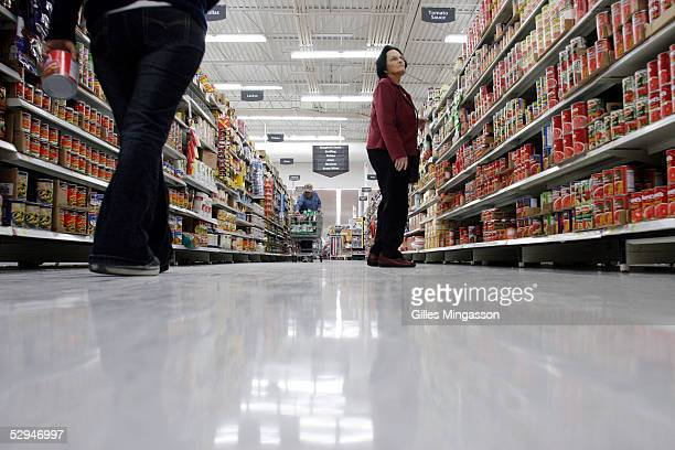 Shoppers look for merchandise at a WalMart store March 14 2005 in Bentonville Arkansas Based in the small town of Bentonville Arkansas with 15...