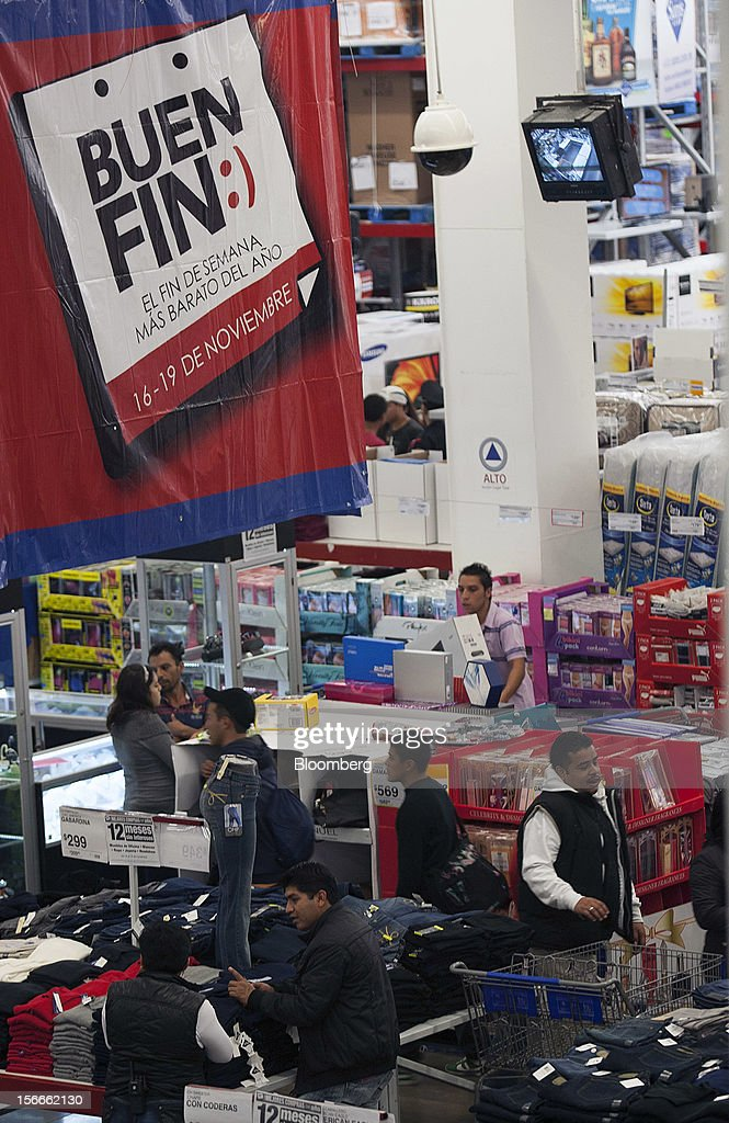 Shoppers look for merchandise inside a Sam's Club store in Mexico City, Mexico on Saturday, Nov. 17, 2012. El Buen Fin, Mexico's equivalent of Black Friday, when the year's biggest discounts are offered by participating stores, is held on the third weekend of November and will run through Nov. 19. Photographer: Susana Gonzalez/Bloomberg via Getty Images