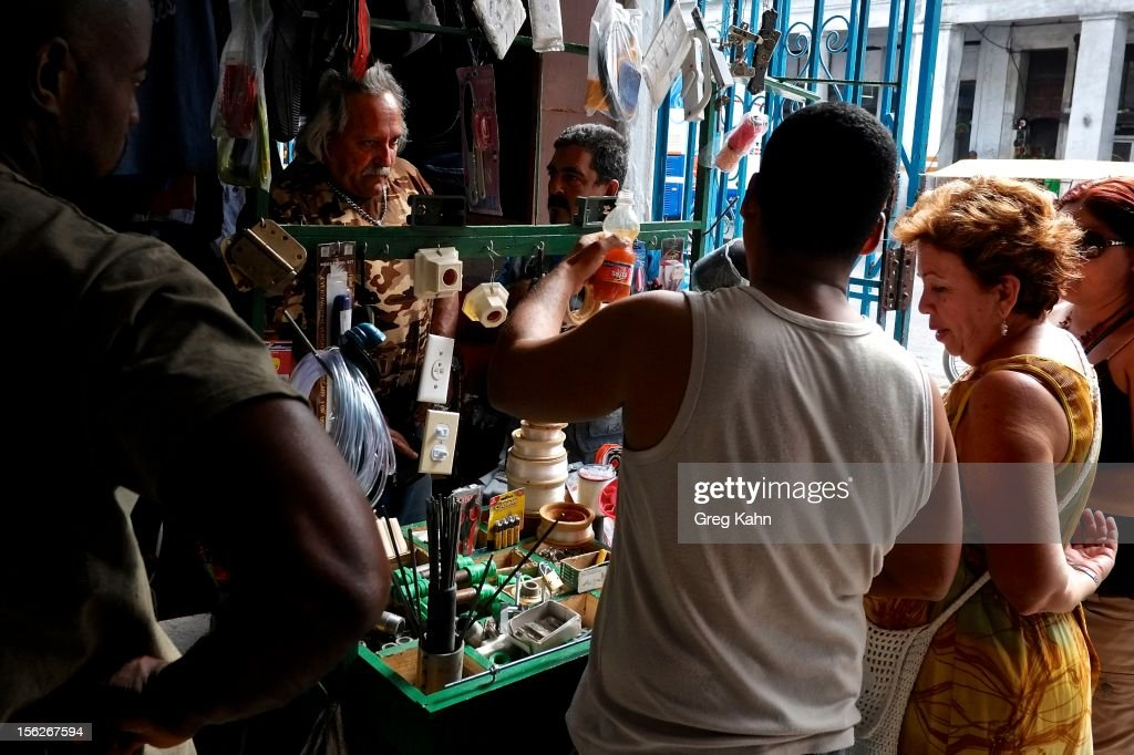 Shoppers look for needed items in the new private markets in Old Havana on November 12, 2012 in Havana, Cuba. New business regulations in the communist country have allowed thousands of citizens to make money for themselves for the first time since 1959.