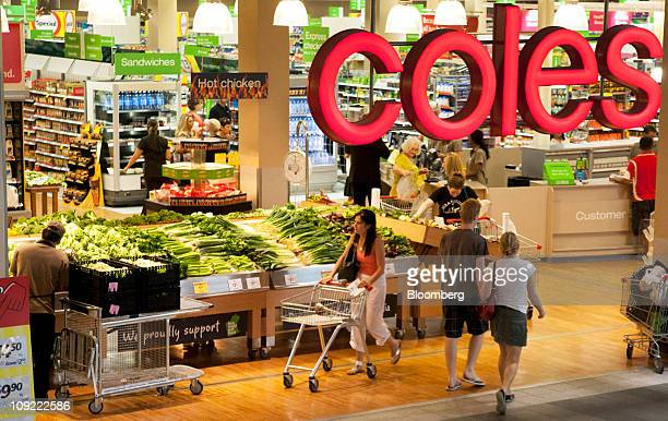 Shoppers look in the produce section of Wesfarmers Ltd's Coles supermarket in Claremont a suburb of Perth Australia on Thursday Feb 17 2011...