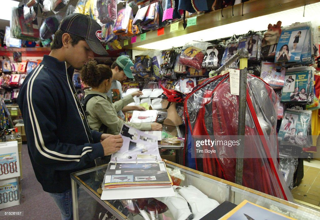 shoppers look through catalogs for halloween items at fantasy costumesoctober 21 2004 in chicago - Halloween Catalogs
