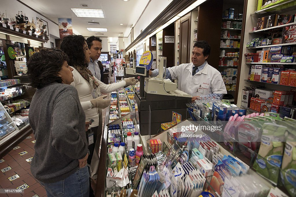 Shoppers make a purchase in the pharmacy section of a Grupo Sanborsn SAB store in Mexico City, Mexico, on Friday, Feb. 8, 2013. Grupo Sanborns SAB, the retailer controlled by Mexican billionaire Carlos Slim, raised 10.5 billion pesos ($825 million) in an initial public offering (IPO) last week and the total could climb to 12.1 billion pesos including an overallotment option for underwriters. Photographer: Susana Gonzalez/Bloomberg via Getty Images