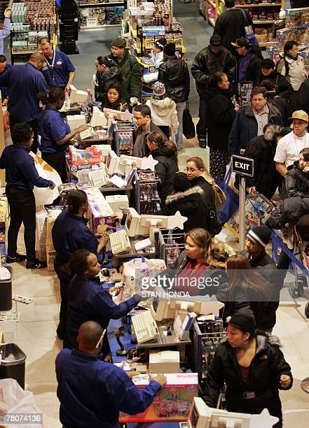 Shoppers make purchases 23 November 2007 at the Toys 'R' Us store in New York's Times Square on Black Friday the traditional start of the holiday...