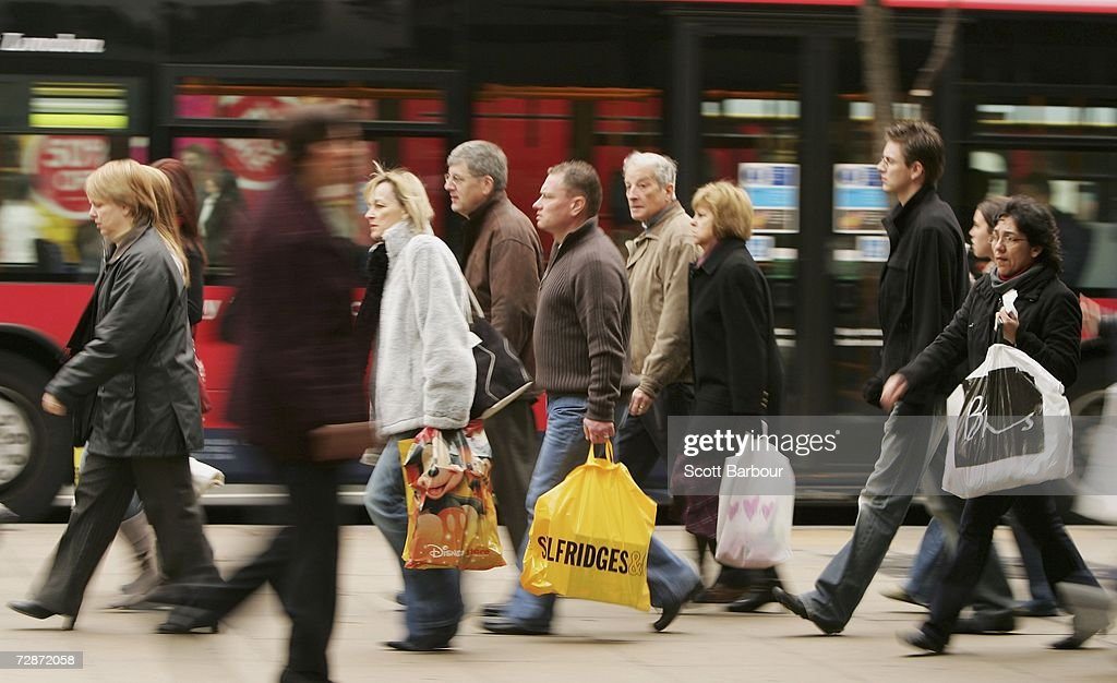 Shoppers make their way along Oxford Street on December 23, 2006 in London, England. With just two days to go before Christmas, the streets are busy with people are finishing their last-minute Christmas shopping.