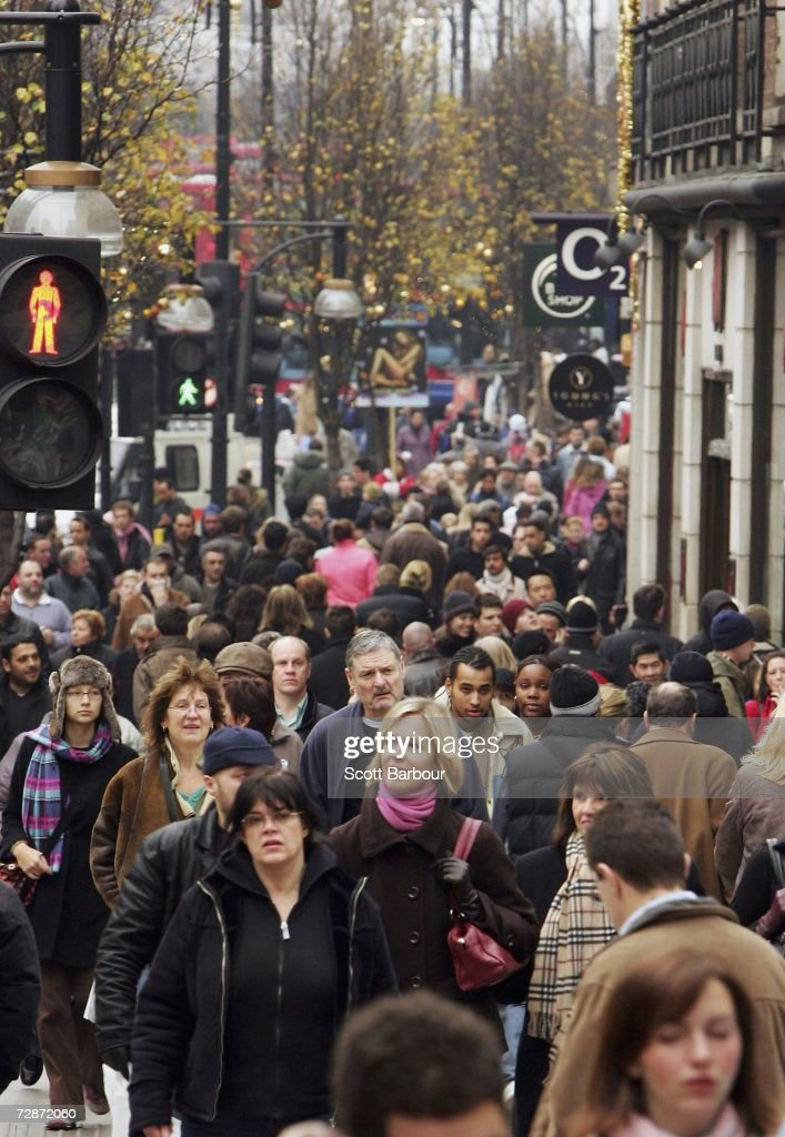 Shoppers make their way along Oxford Street on December 23, 2006 in London, England. With just two days to go before Christmas, the streets are busy with people as they are finishing their last-minute Christmas shopping.