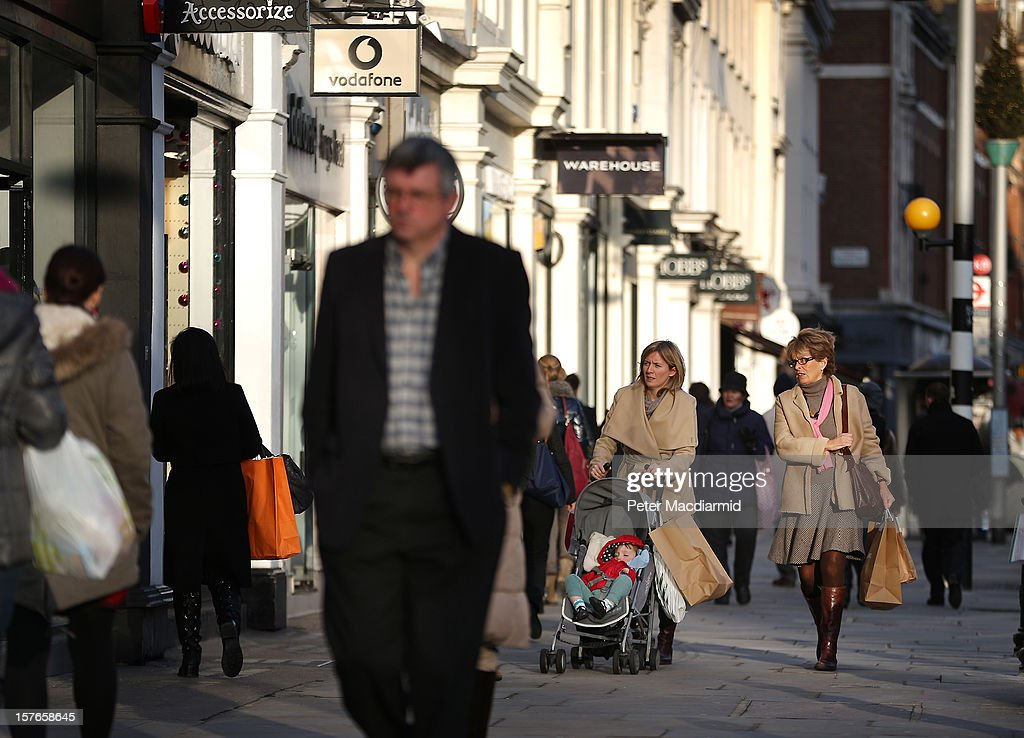 Shoppers make their way along the King's Road in Chelsea on December 5, 2012 in London, England. The Chancellor of the Exchequer George Osborne has stated that the United Kingdom's economy is still struggling during his Autumn budget statement to Parliament.