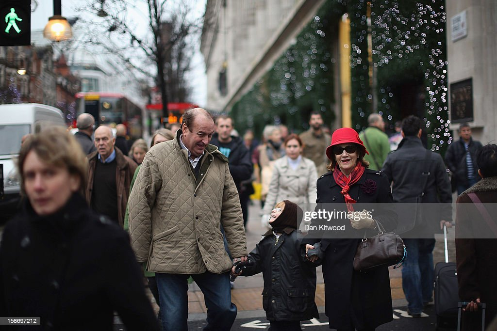 Shoppers make their way down Oxford Street on December 24, 2012 in London, England. Many high street retailers have started their sales two days early this year on what is expected to be the busiest shooping day of the year.