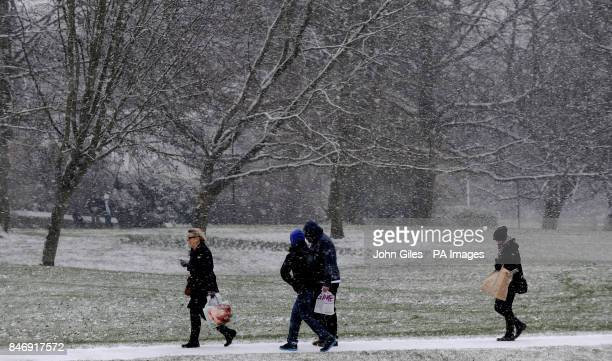 Shoppers make their way through falling snow in Harrogate as forecasters warn of severe weather over the weekend PRESS ASSOCIATION Photo Picture date...