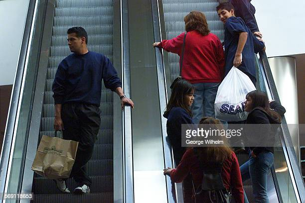 – Shoppers make their way up and down the eascalators at the Northridge Fashion Center mall in Northridge today