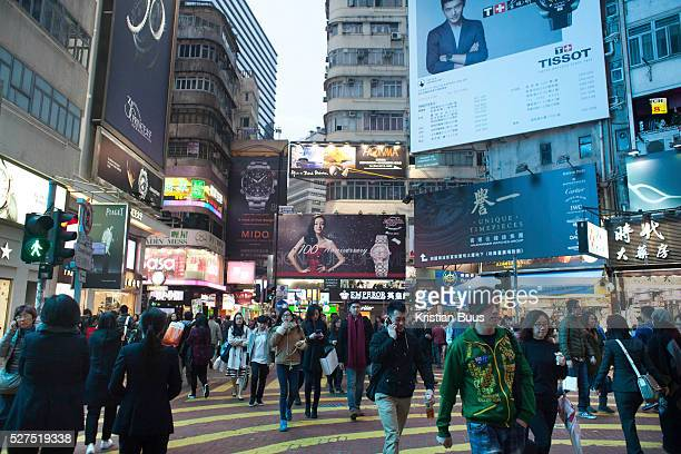 Shoppers mill about in Times Square Wan Chai 7 million people live on 1104km square making it Hong Kong the most vertical city in the world