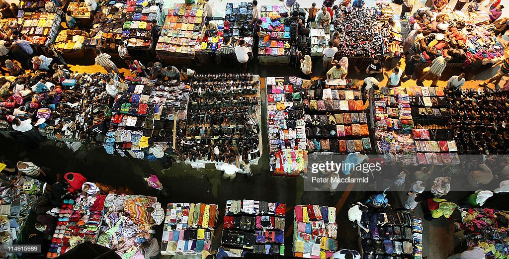 Shoppers move among tables containing clothes and shoes at Ataba market on May 28, 2011 in Cairo, Egypt. Protests in January and February brought an end to 30 years of autocratic rule by President Hosni Mubarak who will now face trial. Food prices have doubled and youth unemployment stands at 30%. Tourism is yet to return to pre-uprising levels.