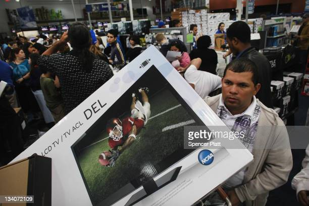 Shoppers move through a Best Buy store on November 25 2011 in Naples Florida Although controversial many big retail stores decided to get a head...