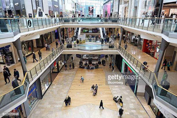 Shoppers move through the interior of the Bullring shopping centre in Birmingham UK on Tuesday Oct 4 2016 UK consumers appear to be shrugging off...