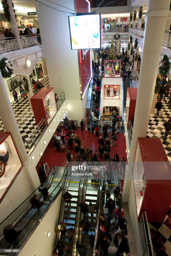 Shoppers move through the Manhattan Mall during the Black Friday sales on November 23, 2012 in New York City. Shoppers filled stores in search of the many potential bargains on offer during the traditional yearly sale, which got its name as it's said to put retailers 'in the black,' or making a profit.