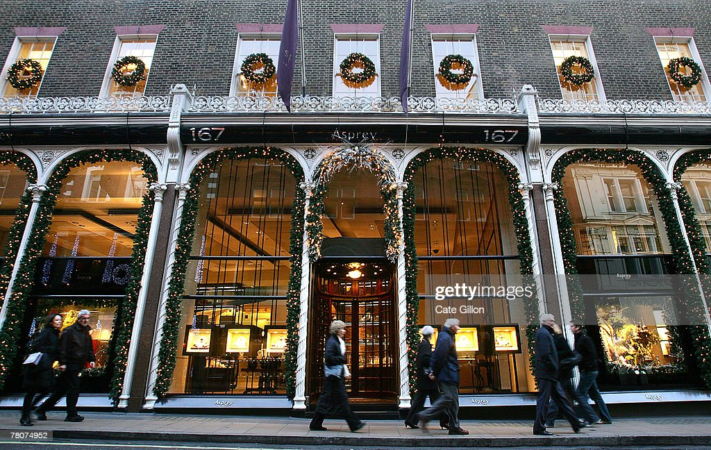 Shoppers on Bond Street pass London's luxury store Asprey on November 23 2007 in London London's stores have had their windows decorated accordingly...