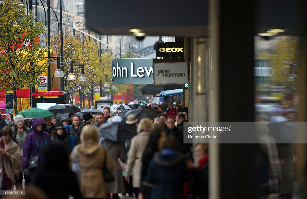 Shoppers on Oxford Street on November 24, 2012 in London, England. Oxford Street was closed to traffic for its annual pedestrian only Christmas Shopping.