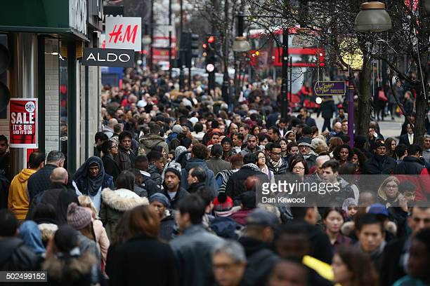 Shoppers on Oxford Street walk during the Boxing Day sales on December 26 2015 in London England Boxing Day is one of the busiest days for retail...