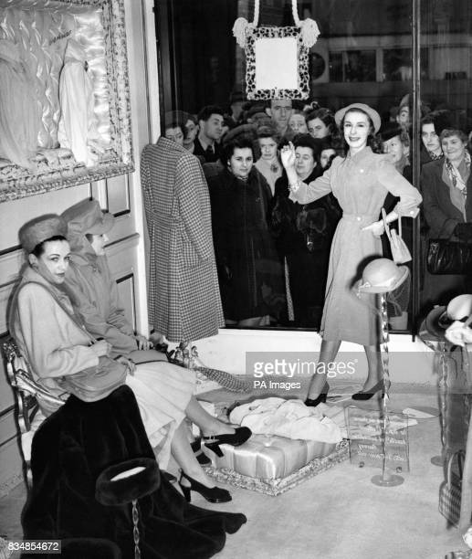 Shoppers on Regents Street gaze at the smartest London fashions instead of the usual wax dummies they had flesh and blood models displaying the...