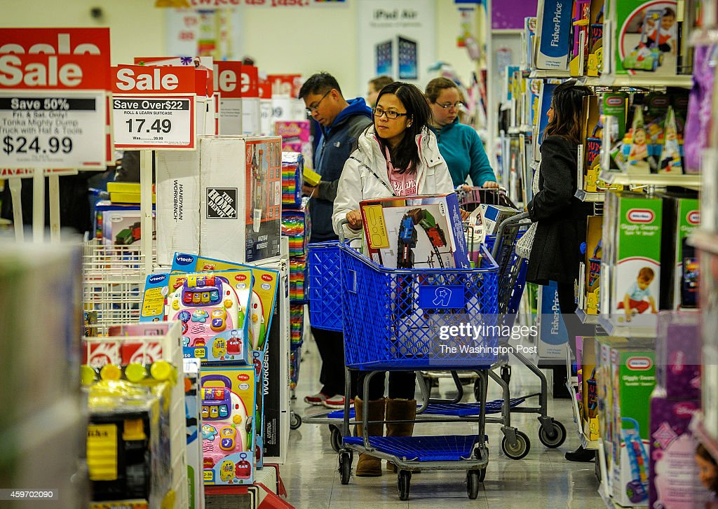 Shoppers on the hunt for toy sales on Black Friday at the Toys R Us on November 2014 in Vienna VA