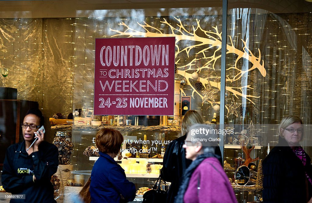 Shoppers pass a Christmas window display on Oxford Street on November 24, 2012 in London, England. Oxford Street was closed to traffic for its annual pedestrian only Christmas Shopping.